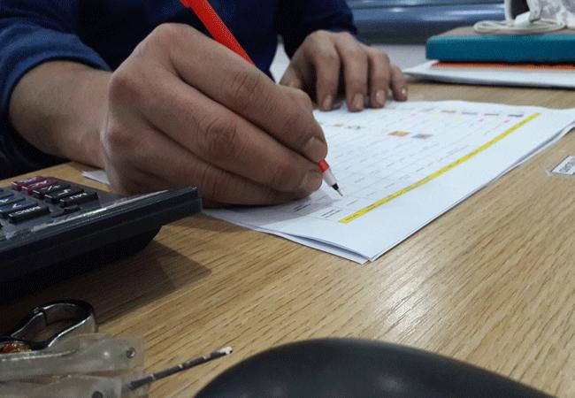 Merchandiser Preparing the Price sheet for Buyer Textile Student